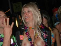 Sexy MILF flashers flashing tits and pussy in public places