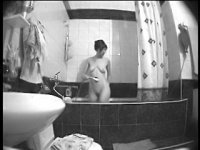 Bathroom hidden camera films an amiable girl