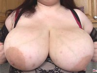 Plumper Madison Blush wrapping her giant melons in clingfilm