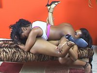 These black lesbian lovers try to see how deep they can get their tongues and their toys inside of them