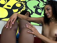 The tight black slits on these two lesbians are gaped open by a double dong as they fuck