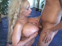 Watch this lucky dude as pornstar Echo Valley squeezes his dick with her big breasts