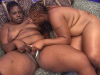 Black lesbian fatties Brownie Girl and Sweet Vanilla enjoy giving each other a wet tongue fucking