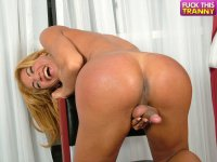 Blonde dickgirl exposes her tight chocolate hole