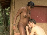 Brown shemale lets a guy suck her hardening nipples before probing his ass