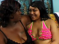 Chubby black lesbians munch their carpet before sliding sex toys into their wet pussies