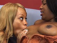 Having black lesbian sex with a vibrator and a thick strapon dildo makes both of these girls scream loudly