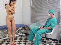 Med exam of a sports babe. Male doctor examines a sexy gymnast
