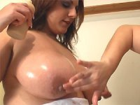 Britsh babes Kerry Marie and Mellie D oil up their huge tits