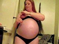Pregnant blonde masturbating in the kitchen