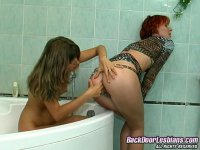 Kinky lesbian chicks stretching butts with double-headed dildo in bathroom