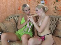 Blonde lezzie takes out a sex toy and asks her girlfriend for anal workout