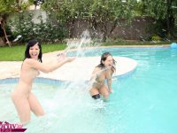 Cute teen lesbians showing off their tits and play in pool