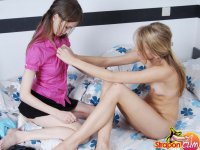 Petite teen fucks her new college roommate hard with a big strap-on