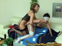 Blindfold gal savoring every tender touch of mature chick on her curvy body