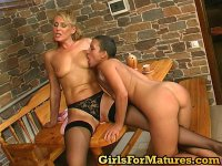 Curvaceous gal opening mature pussy lips with her tongue right on the table