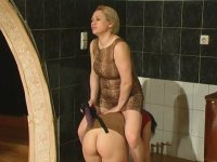 Hot milf getting under the skirt of a girl seducing her into strap-on fuck
