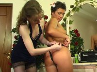 Lewd lesbian mature babe thrusting her tongue and strap-on into young pussy