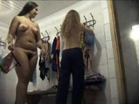 Two chicks with big asses get spycammed in locker