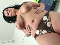 Horny Reny stripping off and playing with her massive melons