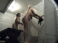 Two mommies shower themselves in front of spy cam