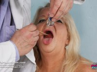 Mature lady Dorota gets naked at gyno office for curious doc