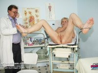 Middle aged Brigita takes vulva enema during senior gyno exam