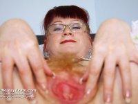 Pervy kinky nurse Olga having fun with pussy spreader on gyno chair