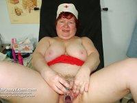 Senior nurse Tana gaping her naughty cunt wide