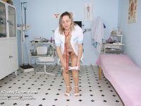 Dirty perverted nurse Jaroslava rubbing pussy with medical instrument on gyno chair