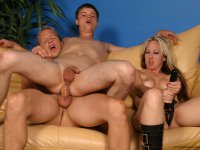 Hot strapon bitch bangs bisexual guys\' holes with a huge dildo while they blowjob each other