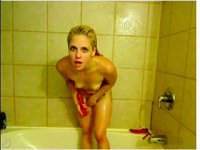 Naked wet blonde gets herself off with dildo in a shower
