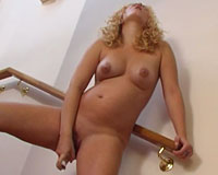 Curly blonde preggo posing naked, spreading her pussy and dildoing right on the stairs