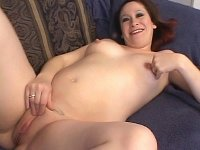Lusty preggy babe splitting her shaved and luscious twat