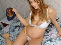 Naughty Nina shows off her curvy pregnant body