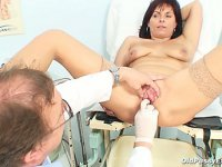 Skilled gyno doctor rubbing a clit of an mature mom Livie during gyno exam