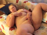 Blonde fatty rubs snatch with a smile on her face