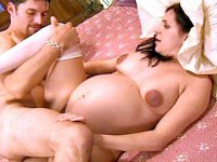 Lactating brunette preggo giving head