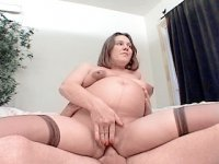 Horny preggo squeezing her huge tits while getting hammered from behind