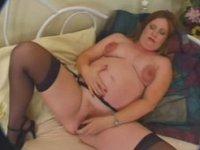 Nasty heavyweight preggy mom in stocking gets horny then dildo-fucking