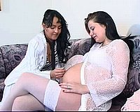 Pregnant chick and her lesbian girlfriend bury their tongues in each other\'s cunts