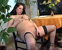 Pregnant chick in sexy fishnets spreads her dripping twat and fucks herself with a shiny dildo