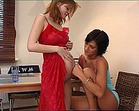Tanned lesbian chick licks her pregnant lover\'s pussy and fucks her with her favorite dildo
