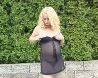Hot pregnant blonde gets naked outdoors to spread her pussy and fuck it with a big glassy sextoy