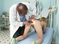 Sam gets a metal medical tool inside her vulva during a gyno examination
