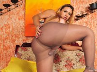 Kinky shemale slipping into her silky pantyhose to stroke her hard pecker