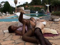 Sex-starved dick-girl and a naughty chick having freaky fun by the pool