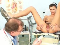 Angela gets a medical instrument up her beaver during gyno examination